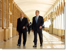 President George W. Bush walks through the halls of St. Petersburg State University with President Vladimir Putin before a question and answer session with students in St. Petersburg, Russian on May 25, 2002. White House photo by Paul Morse.