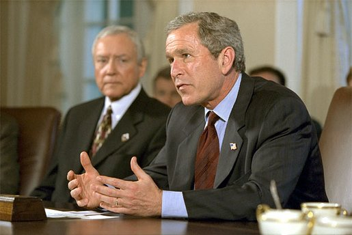"President George W. Bush addresses the media after meeting with members of Congress, including Senator Orrin Hatch of Utah, left, in the Cabinet Room Thursday, May 9. ""There are 30 circuit court vacancies in America, and they've approved seven. This is a bad record, and it's a record that's bad for the country,"" said the President. White House photo by Paul Morse."