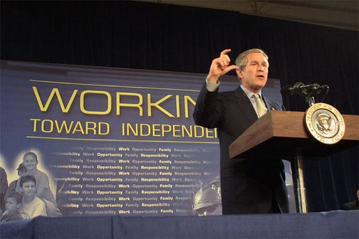 """President George W. Bush discusses welfare reforms during a visit to St. Stephens Community House in Columbus, Ohio, May 10, 2002. """"(St. Stephens) is a living example of what we call a one-stop center, where people who need help are able to come and find help to help themselves."""" White House photo by Paul Morse."""