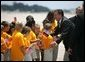 German Chancellor Gerhard Schroeder greets students upon his arrival for the G8 summit at Hunter Army Airfield in Savannah, Ga., June 8, 2004. White House photo by Paul Morse