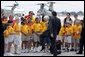 German Chancellor Gerhard Schroeder kicks a soccer ball with students during his arrival for the G8 Summit at Hunter Army Airfield in Savannah, Ga., June 8, 2004. White House photo by Paul Morse