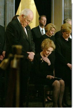 Vice President Dick Cheney, Nancy Reagan and other mourners bow their heads during the State Funeral Ceremony in the Rotunda of the U.S. Capitol Wednesday, June 9, 2004.  White House photo by David Bohrer