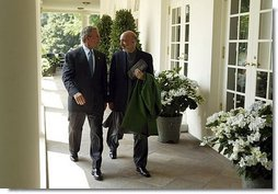 President George W. Bush and Hamid Karzai of Afghanistan walk along the colonnade after holding a joint press conference in the Rose Garden Tuesday, June 15, 2004.  White House photo by Paul Morse