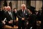Former British Prime Minister Margaret Thatcher is greeted by former Canadian Prime Minister Brian Mulroney and Former Soviet President Mikhail Gorbachev before the funeral service for former President Ronald Reagan at the National Cathedral in Washington, DC on June 11, 2004. White House photo by Paul Morse.
