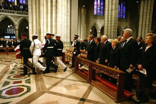 President George W. Bush and Laura Bush, Vice President Dick Cheney and Lynne Cheney, along with four former US Presidents, and other world dignitaries watch as the casket of former President Ronald Reagan is carried into the National Cathedral in Washington, D.C., Friday, June 11, 2004. White House photo by David Bohrer.