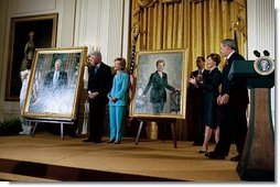 President George W. Bush and Laura Bush host the unveiling of the Clinton portraits as former President Bill Clinton and Senator Hillary Clinton stand by their official White House portraits in the East Room of the White House Monday, June 14, 2004.  White House photo by Paul Morse