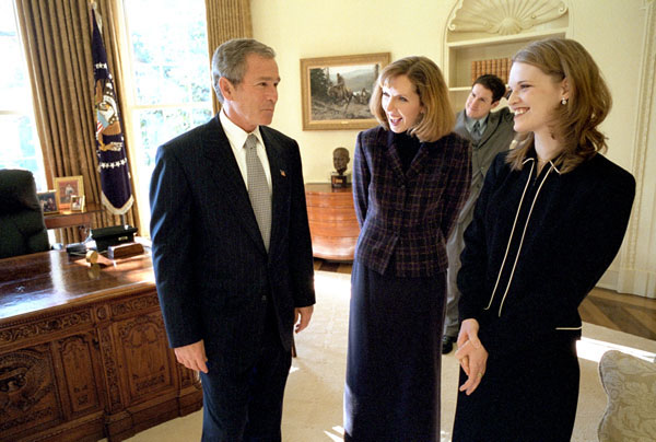 """President George W. Bush talks with Dayna Curry, center, and Heather Mercer in the Oval Office Nov. 26. The two humanitarian workers recently returned to the United States after being held captive by the Taliban regime for three months. """"Heather Mercer and Dayna Curry decided to go to help people who needed help,"""" said the President in his remarks to the media. """"Their faith led them to Afghanistan. One woman who knows them best put it this way: they had a calling to serve the poorest of the poor, and Afghanistan is where that calling took them."""". White House photo by Eric Draper."""