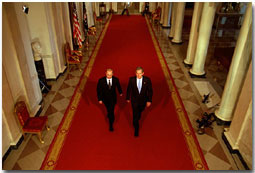 "President George W. Bush and Russian President Vladimir Putin walk out to address the media at the White House Nov. 13. ""This is a new day in the long history of Russian-American relations, a day of progress and a day of hope,"" said President Bush in his remarks. White House photo by Paul Morse."