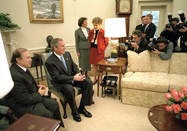 President George W. Bush and Algerian President Abdelaziz Bouteflika talk with the media in the Oval Office Nov. 5. White House photo by Eric Draper.