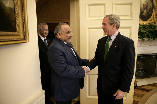 President George W. Bush welcomes Vice President Adil Abd Al-Mahdi of Iraq to the Oval Office Thursday, March 15, 2007. White House photo by Eric Draper