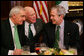President George W. Bush speaks with Ireland's Prime Minister Bertie Ahern, left, and U.S. Senator Patrick Leahy, center, Thursday, March 15, 2007, during the annual St. Patrick's Day luncheon at the U.S. Capitol. White House photo by Joyce Boghosian