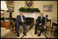 """President George W. Bush talks with Iraqi Vice President Adil Abd Al-Mahdi, Thursday, March 15, 2007, during a meeting with the press in the Oval Office. """"You, Mr. Vice President, are showing strong vision, and a vision of peace and reconciliation,"""" said President Bush, adding, """"And I welcome you to the Oval Office. I thank you for your courage, and I thank you for the conversation we've had."""" White House photo by Eric Draper"""