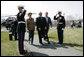 President George W. Bush and Mrs. Laura Bush walk with Brazilian President Luiz Inacio Lula da Silva past an honor guard Saturday, March 31, 2007, during Lula's welcome to Camp David. White House photo by Eric Draper