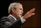 President George W. Bush gestures as he addresses his remarks to United States Hispanic Chamber of Commerce, speaking on Western Hemisphere policy, Monday, March 5, 2007 in Washington, D.C. President Bush, who travels to Latin America later this week, said the two regions are linked by common values, shared interests and growing ties that have helped advance peace and prosperity on both continents. White House photo by Paul Morse