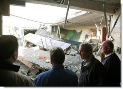 President George W. Bush walks through tornado damage at Enterprise High School in Enterprise, Ala., Saturday, March 3, 2007. The President visited people affected by storms in Americus, Ga., and Enterprise, Ala. White House photo by Paul Morse