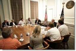 President George W. Bush is joined by Mississippi Governor Haley Barbour, left, and Biloxi, Miss., Mayor A. J. Holloway, right, during a meeting with local leaders Thursday, March 1, 2007 in Biloxi, on the recovery and reconstruction efforts underway in the region devastated by Hurricane Katrina.  White House photo by Eric Draper