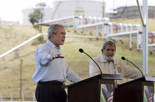 """President George W. Bush and President Lula of Brazil discuss biofuel technology during a joint press conference at Petrobras Transporte S.A. Facility Friday, March 9, 2007, in Sao Paulo, Brazil. """"And so I'm very much in favor of promoting the technologies that will enable ethanol and biodiesel to remain competitive, and therefore, affordable to the people in our respective countries and around our neighborhoods,"""" said President Bush. White House photo by Paul Morse"""