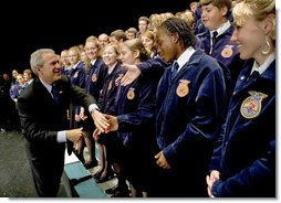 """President George W. Bush greets members of the Pennsylvania FFA at their annual convention at Pennsylvania State University Tuesday, June 14, 2004. """"I appreciate the fact that the Pennsylvania FFA has made a table for the Crawford, Texas FFA. I'm looking forward to telling the folks there at Crawford how decent the good folks here are in Pennsylvania, said President Bush."""" White House photo by Eric Draper"""