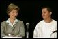 Laura Bush talks with Freddy Martinez, 17, during a roundtable discussion on stopping violent crime in Chicago on June 2, 2005. CeaseFire Chicago is a public health initiative that works with community partners to reduce violence. White House photo by Krisanne Johnson