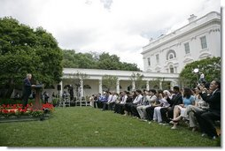 "President George W. Bush addresses 200 exchange students from the program in the Rose Garden Monday, June 13, 2005. Living with host families for one year, the students come from mostly Muslim countries. ""I think your generation is going to help shape one of the most exciting periods of history in the broader Middle East and the world,"" said the President. ""It's a period of time when the hope of liberty is spreading to millions."" White House photo by Eric Draper"