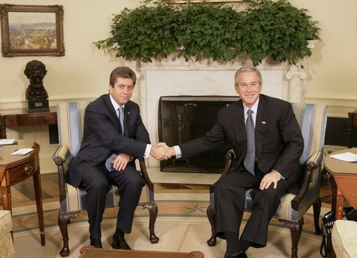 President George W. Bush shakes hands with Bulgarian President Georgi Purvanov prior to taking questions from reporters, Monday, Oct. 17, 2005, in the Oval Office at the White House in Washington. White House photo by Eric Draper