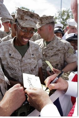 Vice President Dick Cheney shakes hands and signs autographs with U.S. Marine Personnel during a rally at Camp Lejeune in Jacksonville, NC, Monday, October 3, 2005. White House photo by David Bohrer