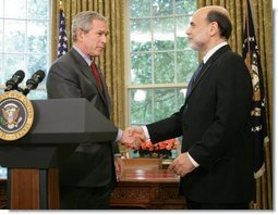 President George W. Bush shakes the hand of Ben Bernanke after announcing his decision to nominate Mr. Bernanke as Chairman of the Federal Reserve, replacing Alan Greenspan upon his retirement in January 2006. The announcement came Monday, Oct. 24, 2005, in the Oval Office.  White House photo by Paul Morse