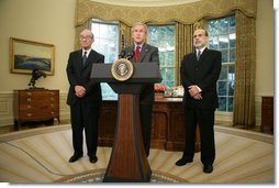President George W. Bush announces his nomination of Ben Bernanke, right, to replace Alan Greenspan, left, as Chairman of the Federal Reserve when Mr. Greenspan's term expires in January. The announcement was made Monday, Oct. 24, 2005, in the Oval Office.  White House photo by Paul Morse