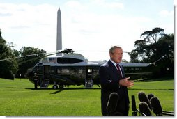 President George W. Bush delivers a statement on Iraqi elections after returning to the White House from Camp David, Sunday,Oct. 16, 2005. White House photo by Krisanne Johnson
