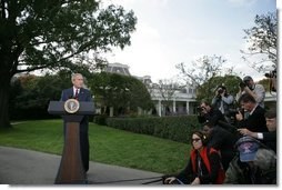 President George W. Bush speaks to the media on the South Lawn regarding the resignation Friday, Oct. 28, 2005, of Vice Presidential Chief of Staff Scooter Libby.  White House photo by Paul Morse