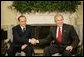 President George W. Bush shakes hands with Italian Prime Minister Silvio Berlusconi, during his visit to the Oval Office at the White House, Monday, Oct. 31, 2005 in Washington. White House photo by Eric Draper