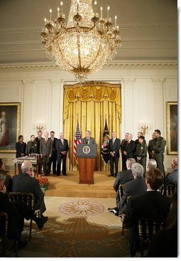 President George W. Bush addresses an audience of legislators, cabinet members and law enforcement officials, Tuesday, Oct. 18, 2005 in the East Room of the White House, prior to signing the Homeland Security Appropriations Act for fiscal year 2006.  White House photo by Paul Morse
