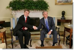 """President George W. Bush and Prime Minister Ferenc Gyurcsany of Hungary shake hands during a photo opportunity in the Oval Office of the White House Friday, Oct. 7, 2005. The President told the media he appreciated the Prime Minister's understanding of the """"importance of democracy and freedom,"""" and thanked him for his leadership. White House photo by Paul Morse"""