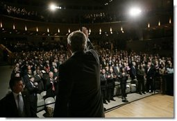 President George W. Bush waves and acknowledges the applause of the audience, following his remarks on the War on Terror, Thursday, Oct. 6, 2005, speaking before the National Endowment for Democracy at the Ronald Reagan Building and International Trade Center in Washington.  White House photo by Eric Draper