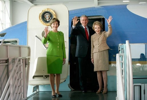 President George W. Bush, Laura Bush and Nancy Reagan wave after touring the plane that served as Air Force One for President Ronald Reagan and six other Presidents from 1973-2001at the Ronald Reagan Presidential Library in Simi Valley, California, Friday, Oct. 21, 2005. White House photo by Eric Draper