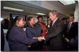 """Federal Emergency Management Agency employees greet President Bush during his visit to the agency's headquarters to thank them for recent days of hard work Oct. 1. """"I'm proud of the work that the FEMA employees all across the country are doing on behalf of America,"""" said the President in his remarks. White House photo by Tina Hager."""