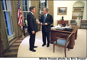 President George W. Bush meets with his new Director of Homeland Security Tom Ridge in the Oval Office shortly before swearing Mr. Ridge in for the position at a White House ceremony Monday, Oct. 8. White House photo by Eric Draper.