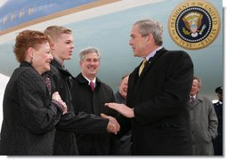 President George W. Bush greets Greece Athena High School senior, Jason McElwain and McElwain's mother, Debbie, upon arriving in Rochester, New York Tuesday, March 14, 2006. After serving as the team's manager McElwain, who is autistic, was called on to play during the team's last game of the season. McElwain became a local hero after he sank six 3-point shots during the last moments of his first ever varsity basketball game. White House photo by Kimberlee Hewitt