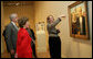 """Mrs. Laura Bush listens Thursday evening, March 9, 2006 to Jane Milosch, curator of the Smithsonian American Art Museum's Renwick Gallery in Washington, as Mrs. Bush is shown the famous Grant Wood painting """"American Gothic,"""" during a tour of the Renwick Gallery exhibit, """"Grant Wood's Studio: Birthplace of American Gothic,"""" scheduled to open Friday, March 10, 2006. Mrs. Bush is accompanied on the tour by Ned. L. Rifkin, under secretary of art at the Smithsonian Institution. White House photo by Shealah Craighead"""