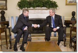 President George W. Bush welcomes NATO Secretary General Jaap de Hoop Scheffer to the Oval Office at the White House, Monday, March 20, 2006 in Washington.  White House photo by Kimberlee Hewitt