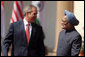 """President George W. Bush smiles as he stands with India's Prime Minister Manmohan Singh during a press availability in New Delhi Thursday, March 2, 2006. The President told those in attendance that India and America """"have built a strategic partnership based on common values,"""" and thanked the Indian people and the Indian government """"for supporting the new democracy in the neighborhood."""" White House photo by Paul Morse"""