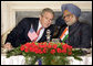 President George W. Bush leans in to speak with India's Prime Minister Manmohan Singh during meetings Thursday, March 2, 2006, in New Delhi. White House photo by Eric Draper