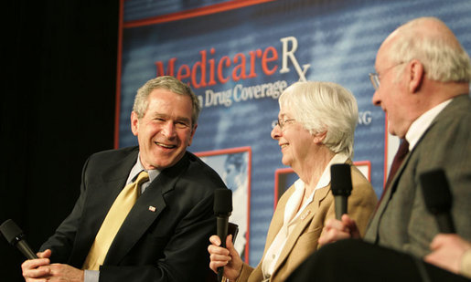 President George W. Bush participates in a Conversation on the Medicare Prescription Drug Benefit, Tuesday, March 14, 2006 at the Canandaigua Academy in Canandaigua, N.Y., speaking with Bob and Eleanor Wisnieff. White House photo by Kimberlee Hewitt