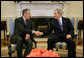 President George W. Bush welcomes Russian Foreign Minister Sergei Lavrov to a meeting in the Oval Office, Tuesday, March 7, 2006, at the White House. White House photo by Paul Morse