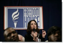 An audience member directs a question to President George W. Bush during his appearance at Freedom House, Wednesday, March 29, 2006 in Washington, where President Bush discussed Democracy in Iraq and thanked the Freedom House organization for their work to expand freedom around the world. White House photo by Eric Draper