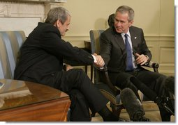 President George W. Bush and Prime Minister Mikulas Dzurinda of Slovakia, exchange handshakes during remarks in the Oval Office of the White House Monday, March 13, 2006. President Bush thanked the Prime Minister for his contributions to helping the young democracies in Afghanistan and Iraq succeed.  White House photo by Paul Morse