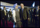 President George W. Bush is welcomed to India by Indian Prime Minister Manmohan Singh upon Air Force One's arrival Wednesday, March 1, 2006, at Indira Gandhi International Airport. The President and First Lady are scheduled to spend three days in the country before flying to Pakistan. White House photo by Eric Draper