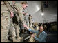 Mrs. Laura Bush greets U.S. and Coalition troops Wednesday, March 1, 2006, during a stopover at Bagram Air Base in Afghanistan, prior to the President and Mrs. Bush visiting India and Pakistan. White House photo by Eric Draper