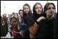 Women stand outside the U.S. Embassy in Kabul, Afghanistan Wednesday, March 1, 2006. President George W. Bush and Laura Bush made a surprise visit to the city and presided over a ceremonial ribbon-cutting at the embassy before continuing their trip to India. White House photo by Eric Draper