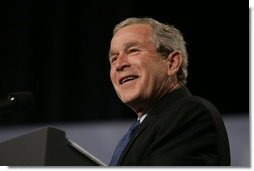 President George W. Bush reacts to a question from the audience at the Renaissance Cleveland Hotel in Cleveland, Ohio, while delivering his remarks on the global war on terror, Monday, March 20, 2006, to members of the City Club of Cleveland.  White House photo by Paul Morse